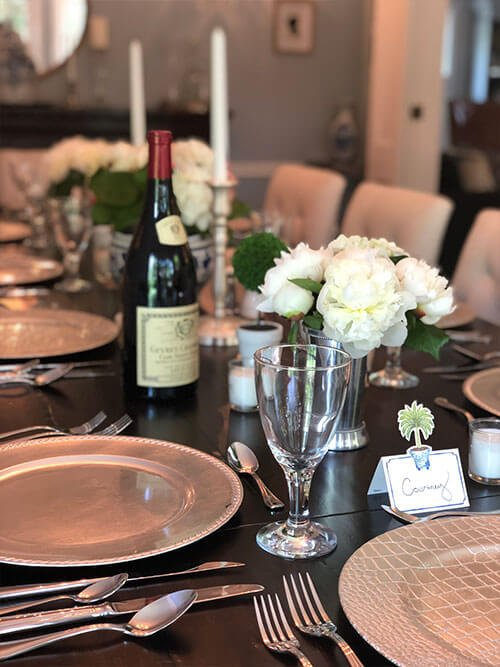 Photo of a table with place settings and wine