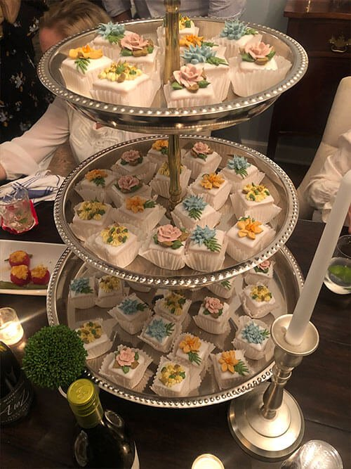 Pastries on a 3-tier silver serving trey